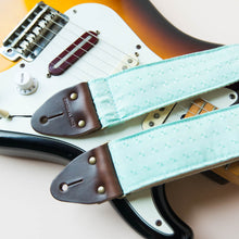 Vintage guitar strap made with light blue satin by Original Fuzz.