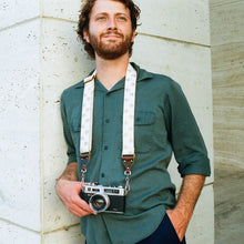 Eyeball silkscreened vintage-style skinny camera strap made by Original Fuzz in Nashville.