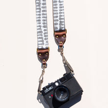 White and gray vintage-style skinny camera strap made with fabric block printed in India by Original Fuzz in Nashville, TN.