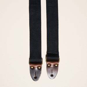 Solid black cotton canvas skinny guitar strap made by Original Fuzz in Nashville.
