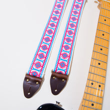 Close-up of the vintage jacquard pattern in the academy street guitar strap