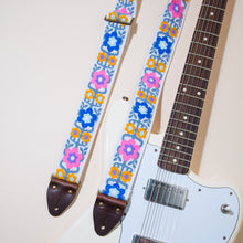 The vintage guitar strap in Fryemont street with a Fender Jaguar