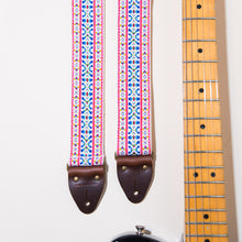 The jacqaurd in this guitar strap has a beautiful rainbow of colors