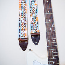 Another view of the vintage guitar strap in Merrimon Ave with a Fender Jaguar