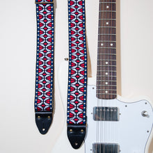 The vintage guitar strap in Patton Ave features black horween leather end tabs