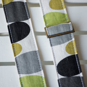 Vintage guitar strap with a retro lime green and black circle design made by Original Fuzz in Nashville, TN.