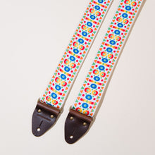 Detail view of the vintage guitar strap in Tabernacle Road