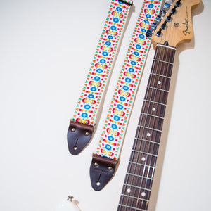 The Vintage Guitar Strap in Tabernacle Road next to a Fender headstock