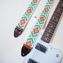 The vintage guitar strap in Town Mountain Road with a white Fender Jaguar