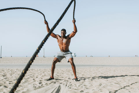 Man doing crossfit with ropes on the beach, for The Core blog