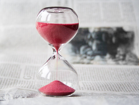 Hour glass with red sand running, for The Core blog