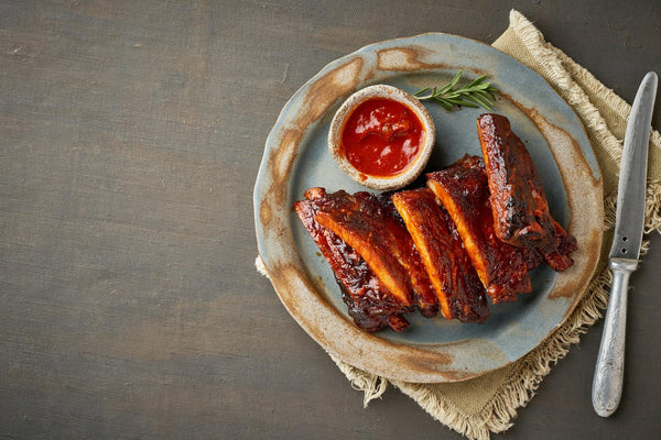 Ribs on a plate with dipping sauce