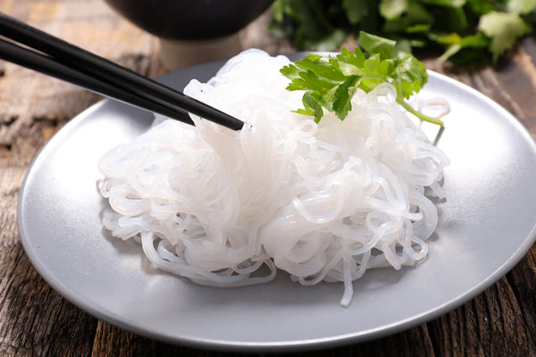 Shirataki noodles on a plate with chopsticks