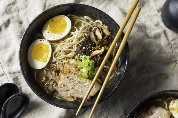 Bowl of ramen with chopsticks resting on top