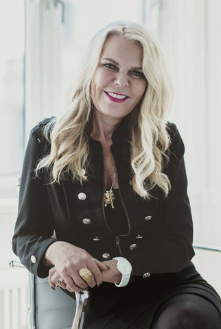Inger Ellen wearing a black buttoned jacket smiling