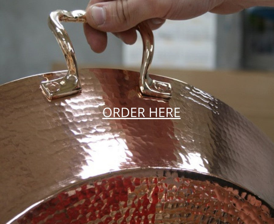 a copper paella pan hand-hammered by amoretti brothers