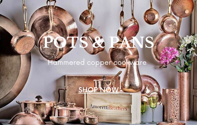 a display of hammered copper pots, pans, fry pans and cookware sets