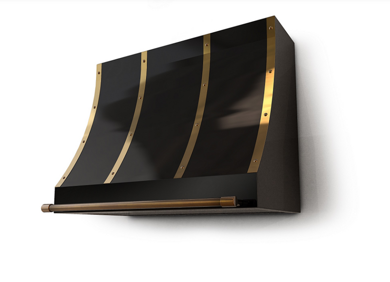 a black range hood with brass decors and rivets