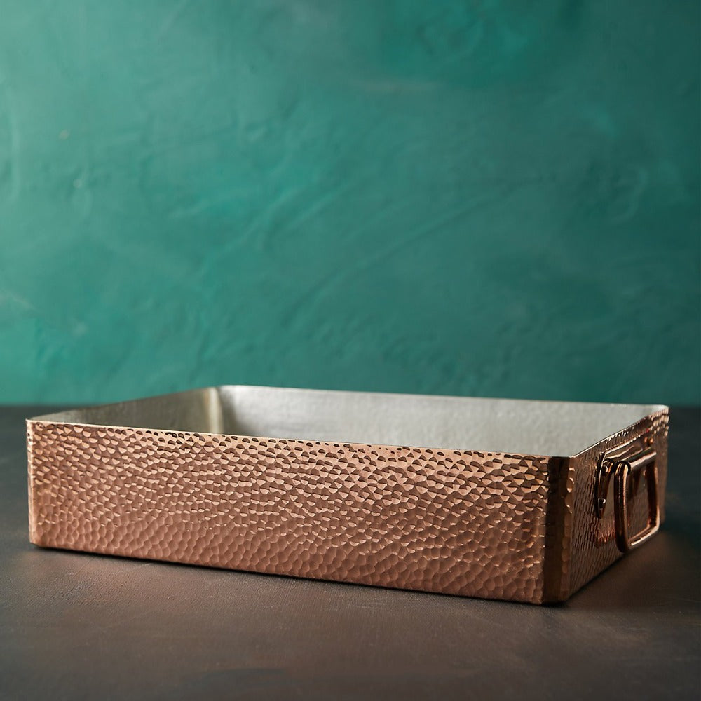 "Built to the Amoretti Brothers standard, this trusty roasting pan is set to be your favorite copper cookware.  Made from hand-hammered copper, our spacious roasting pan provides you with 13.7"" x 9.8"" of cooking area. Double layer tin interior lining covers the entire inner space of the roasting pan. Applied by hand by our copper smiths, this protective covering ensures your roasting pan withstands even the most constant use."