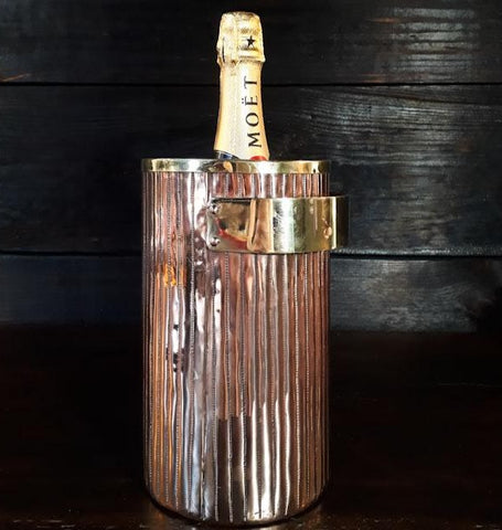 copper ice bucket with moet bottle of champagne by Amoretti Brothers