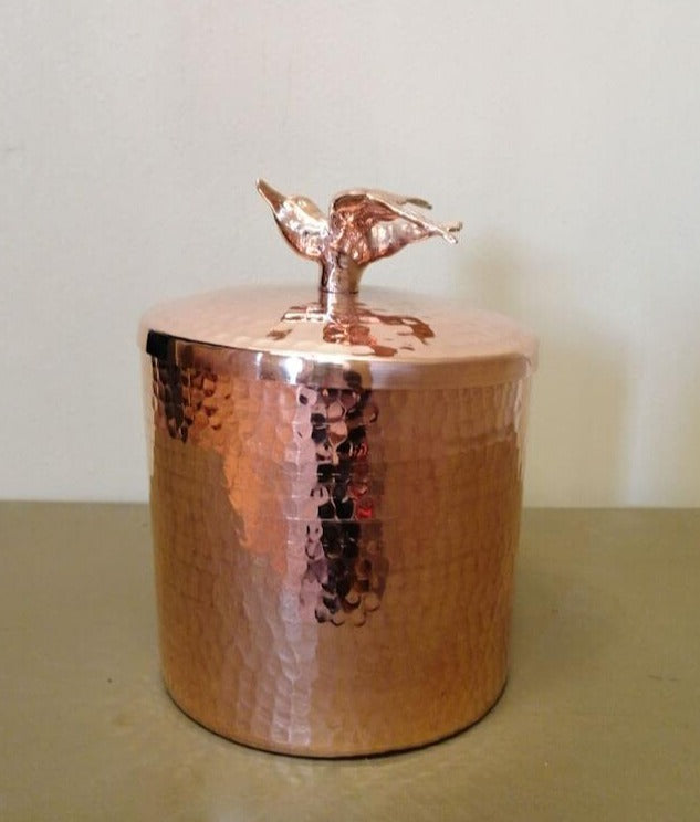 hand-hammered copper canister with bird by Amoretti Brothers