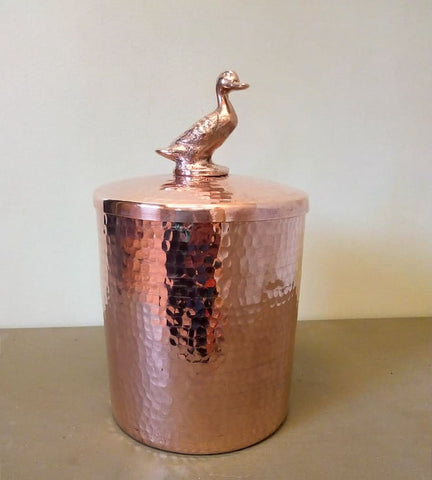 hand-hammered copper canister with duck by Amoretti Brothers