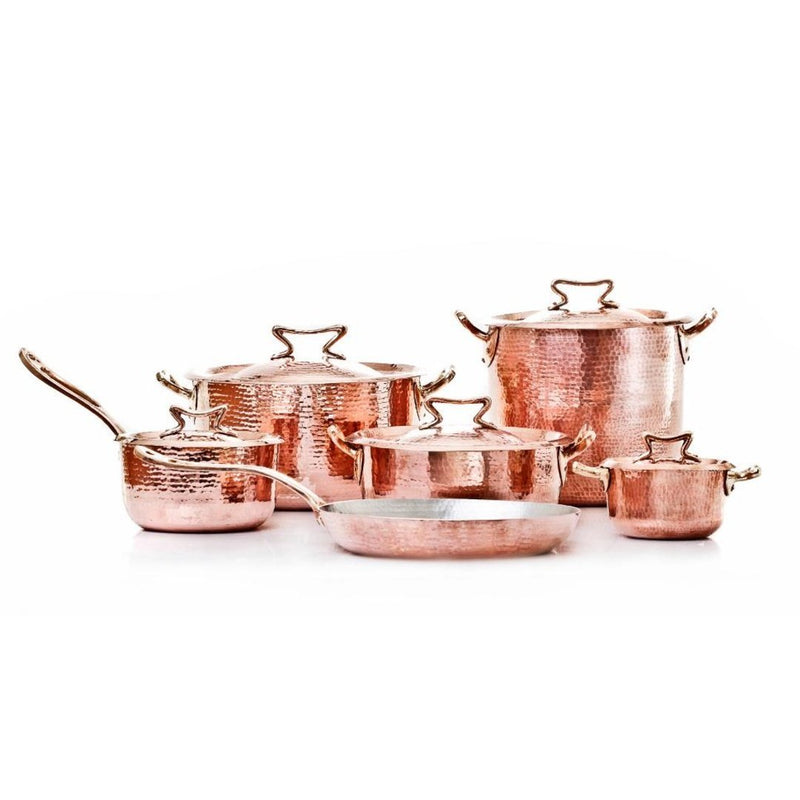 The ultimate luxury copper cookware set by Amoretti Brothers, hand-hammered solid copper with tin lining and our signature cast-bronze Standard lid.