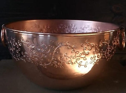 copper mixing bowl with hand-engraved leaves