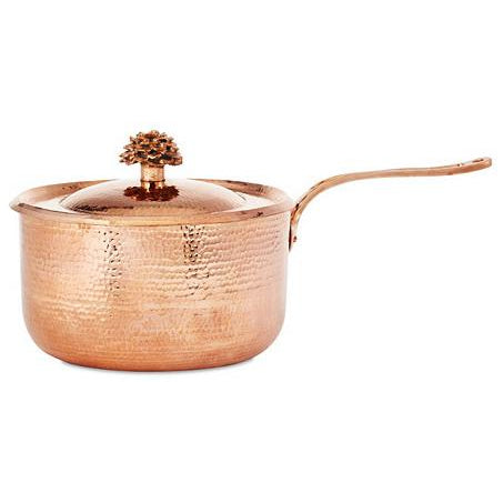 "Turn cooking into an artistic experience with this saucepan from Amoretti Brothers' signature ""Flower"" line.  Made from hand-hammered copper by our expert smiths, this high-capacity copper saucepan can hold up to 4.4 quarts. Its unique blend of beauty and strength makes it the perfect kitchen staple."