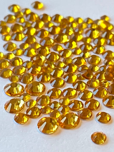 Topaz Gold Crystal Nail Gems (mixed sizes x150)