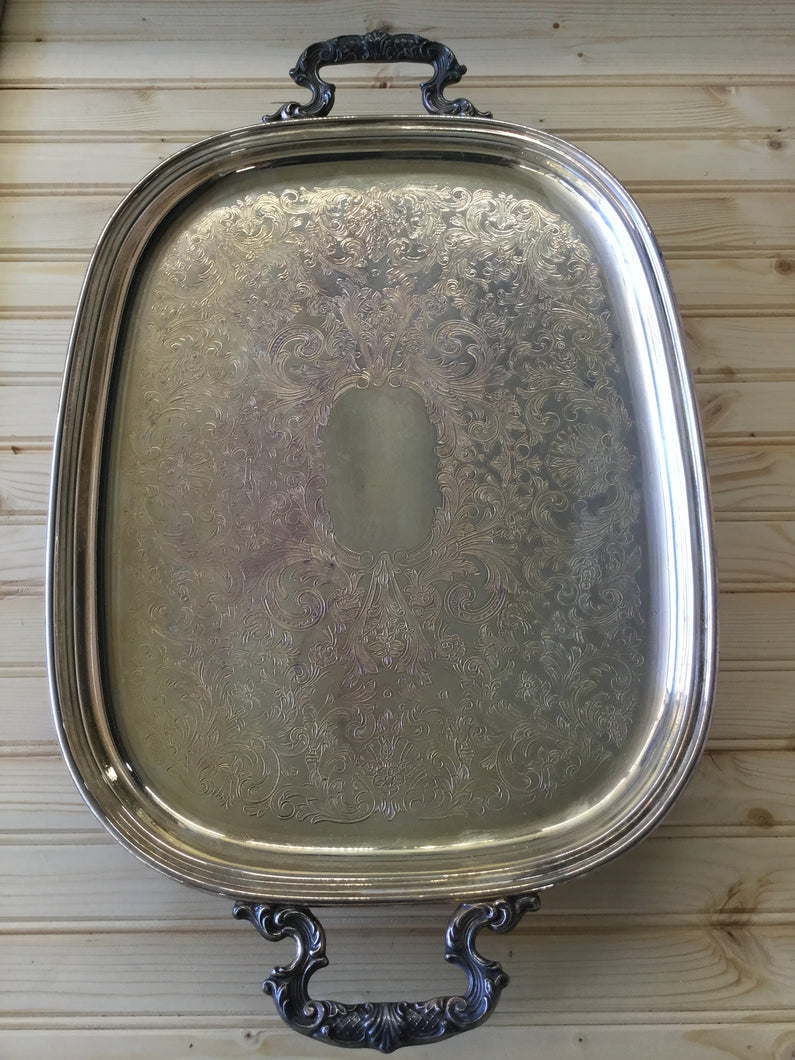 Silver plate tray with decorative handles