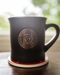 Black Coffee Mug gracefully adorned with the Seal of the President of the United States.