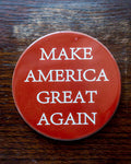 "Red Ceramic MAGA Coaster or set of Coasters.  Sold individually or in 6-packs.  Each coaster is 2-1/2"" round with cork backing."