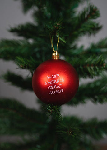 Make Christmas Great Again. Decorate with plenty of red this Christmas. Sprinkle a few Make America Great Again Christmas ball ornaments on the tree, or give them as Christmas gifts. #MAGA