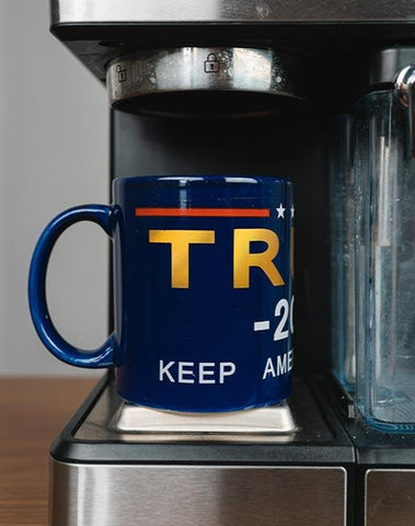 Trump 2020 Keep America Great! Coffee Mug is a great perk to any collection.  Available in Navy Blue with Trump in gold, white 2020 Keep America Great!, and a red stripe accent