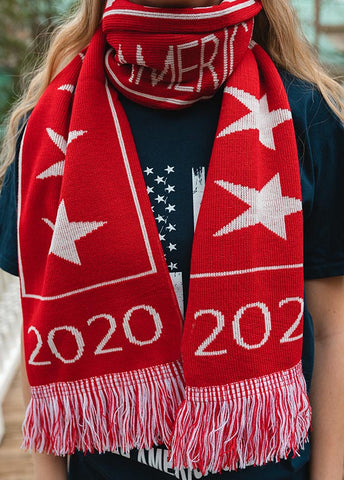Make winter warm again!  Sport this soft, red, and white winter scarf with Trump 2020 and star design on one side and Keep America Great on the other.  Each end of the scarf has 2020 and is adorned with fringe. One size.