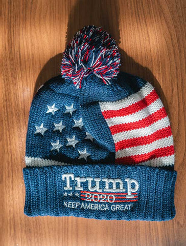 Keep your head warm this winter in a great looking Trump 2020 Knit Hat. The stars and stripes design, multi-colored pom atop, and embroidered stitching in white lettering. NAVY BLUE