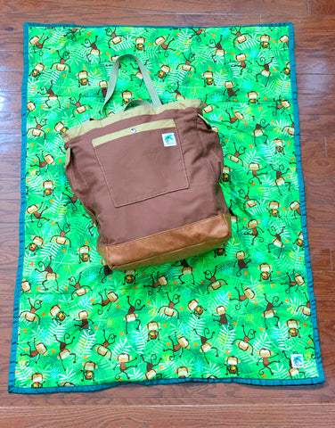 brown bag and monkey play mat