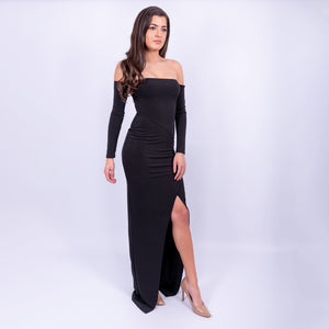 side view of the black bardot long sleeve outline maxi dress with front slit made from a double weight jersey material available to rent at LENDLAB