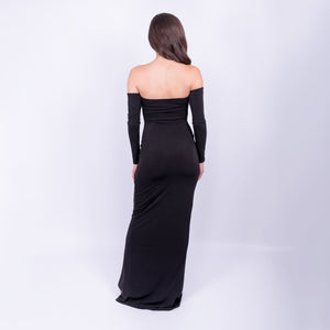 back view of the black bardot long sleeve outline maxi dress with front slit made from a double weight jersey material available to rent at LENDLAB