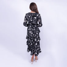 Load image into Gallery viewer, back view of the BIBA constellation print midi dress with skirt ruffles and long sleeves made in a floaty fabric, available to rent from LENDLAB