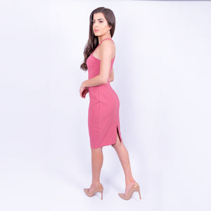 side view of the Likely cross neck sleeveless pencil midi dress with back slit in a dusky rose colour and made from a heavy weight jersey material available to rent at LENDLAB