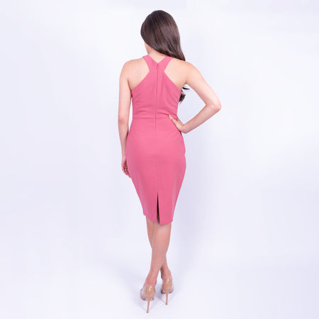 back view of the Likely cross neck sleeveless pencil midi dress with back slit in a dusky rose colour and made from a heavy weight jersey material available to rent at LENDLAB
