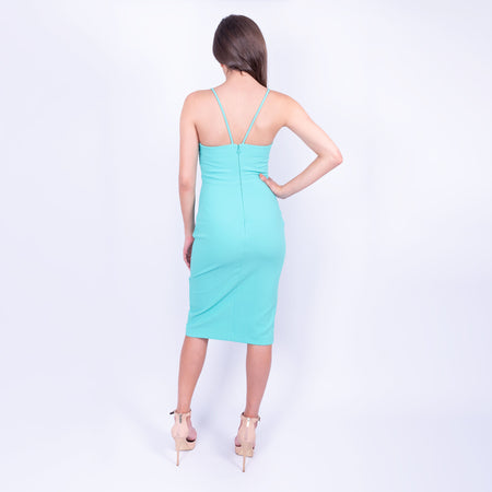 back view of the bright turquoise likely midi dress with spaghetti straps, v-neck bust and front slit in a heavy weight stretch fabric available to rent from LENDLAB