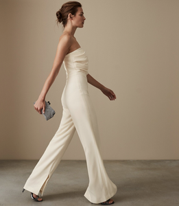 fashionable cream Reiss flared jumpsuit with draped strapless bodice available to rent at lendlab