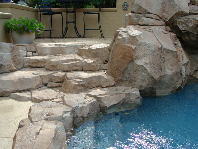 concrete waterfalls concrete pool slides spas and grotto designs exterior firepits exterior concrete steps pool waterlines exterior design in Florida Florida exterior designer Florida landscaping decorator exterior desig