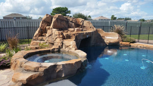 concrete waterfalls concrete pool slides spa and grotto designs exterior firepits exterior concrete steps pool waterlines exterior design in Florida Florida exterior designer Florida landscaping decorator exterior desig
