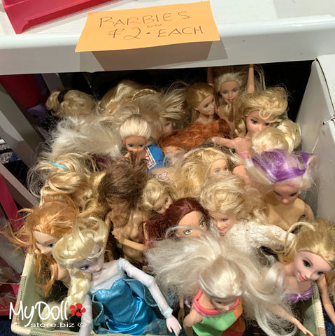 A box of Barbie Dolls for Two Dollars Each