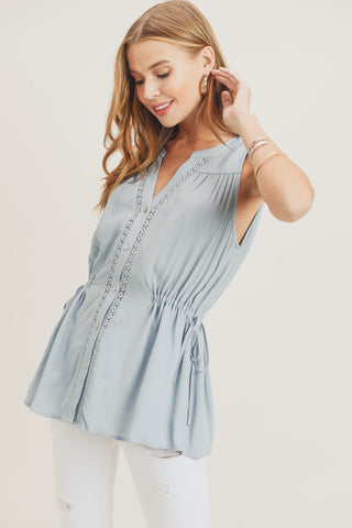 blue sleeveless top ruched with buttons