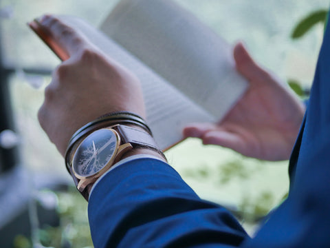 Reading is a simple way to quiet the mind with a Time-Peace watch